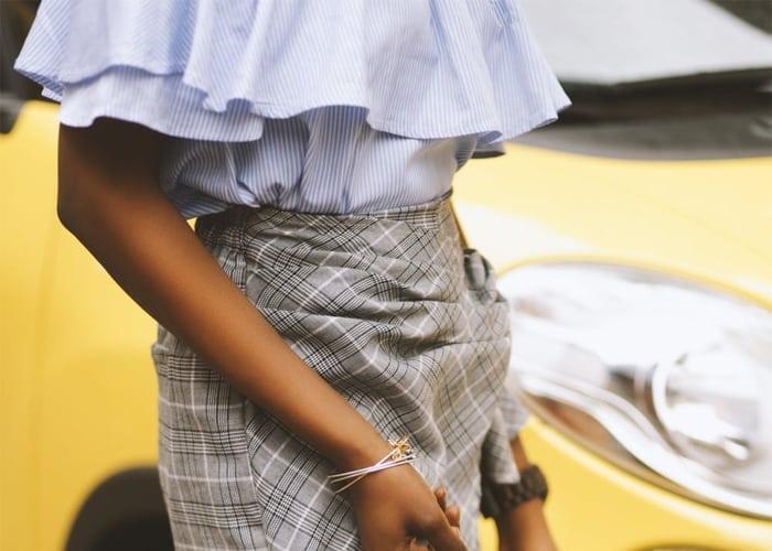 Geruite rok met streepjes blouse